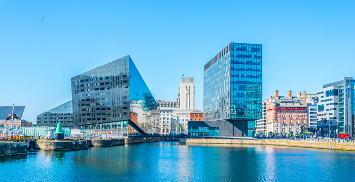 An aerial photograph of the striking glass buildings along Canning Dock in Liverpool, England.