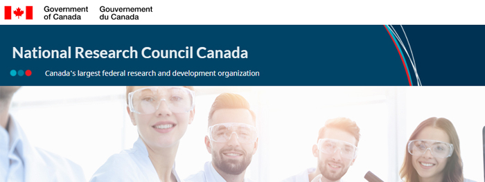A photograph of several scientists in lab coats and goggles. Above it are the Government of Canada logo with Canadian flag and the words 'National Research Council Canada: Canada's largest federal research and development organization'.